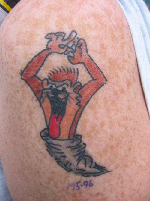 Zack: Tattoo by Jimmy Redfield, Age 8. Dr. Thorpe: Taz looks like he lost a