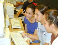Here's some girls using a computer. Anything is possible if you just BELIEVE.