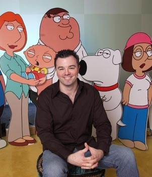 Who's the real cartoon character here? Seth sits to the left of Lisa Griffin, arguably the show's most popular character.