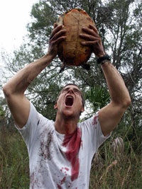 Bear Grylls feeding off the lifeforce of a turtle.