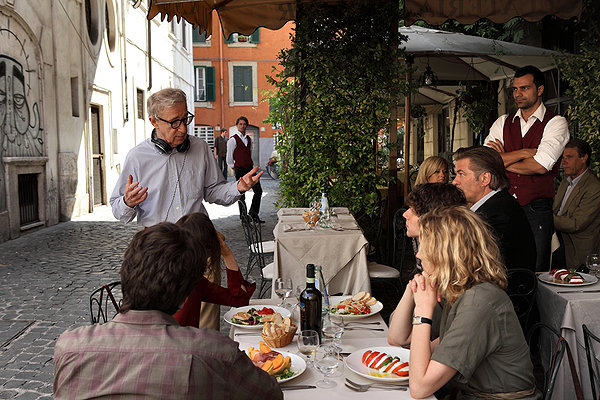 In this candid photo, Woody Allen ambushes innocent diners with self-indulgent stories about himself.