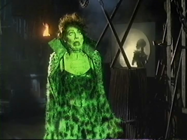 She died as she lived: covered in green light and making a stupid face.